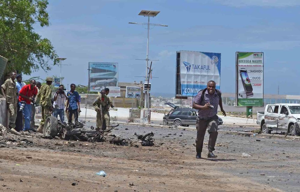 Journalists covering an attack by Al Shabaab militants on the Somali parliament in Mogadishu in May 2014.