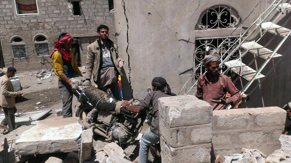 Yemenis in the Bani Hewat district of the capital Sana'a search for survivors clear the rubble after Saudi Arabian planes bombed the area on March 26, 2015