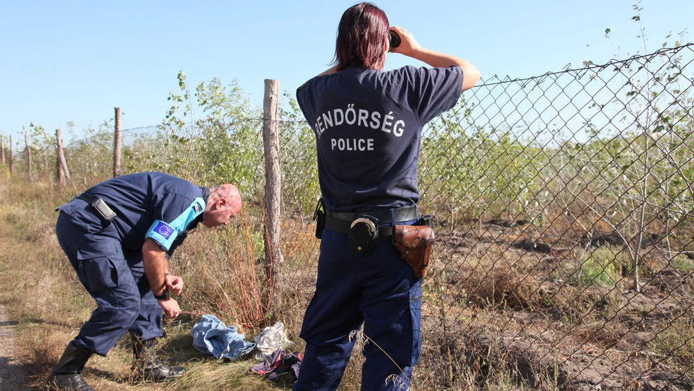 Frontex officers inspected discarded clothing at the Hungarian-Serbian border