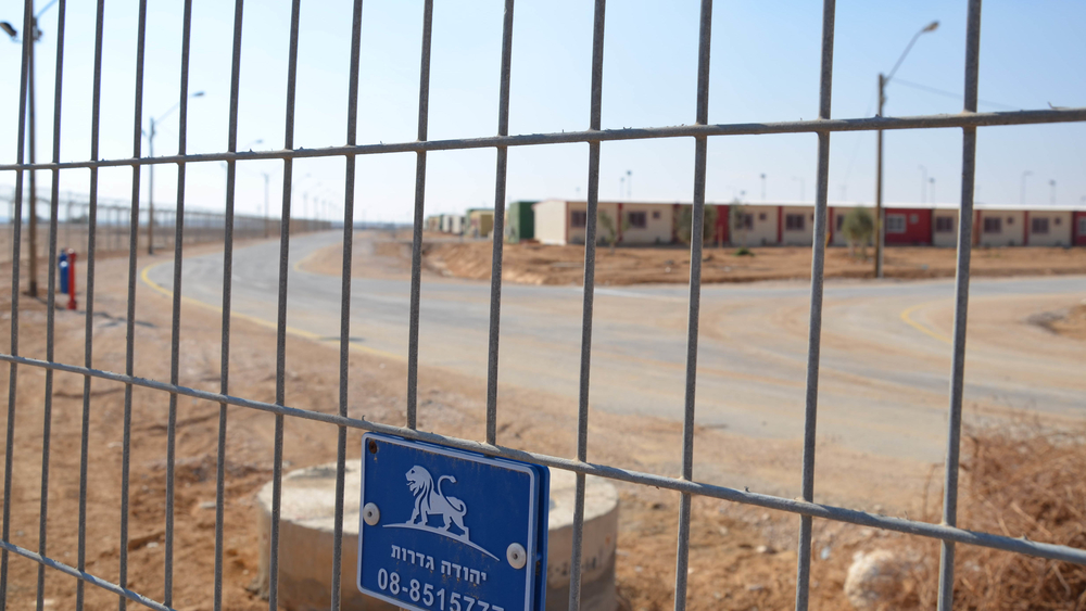 "A view through the fence of Holot ""open"" detention centre in Israel's southern Negev desert"