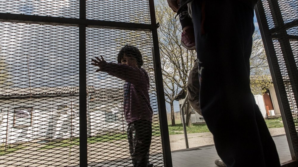 A Syrian child at the entrance to the Krynjaca asylum centre in Belgrade, Serbia.