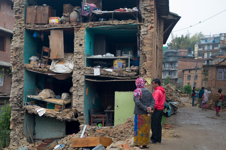 Residents of Bungamati, just outside the Nepali capital Kathmandu, stare at their old homes after a devastating earthquake