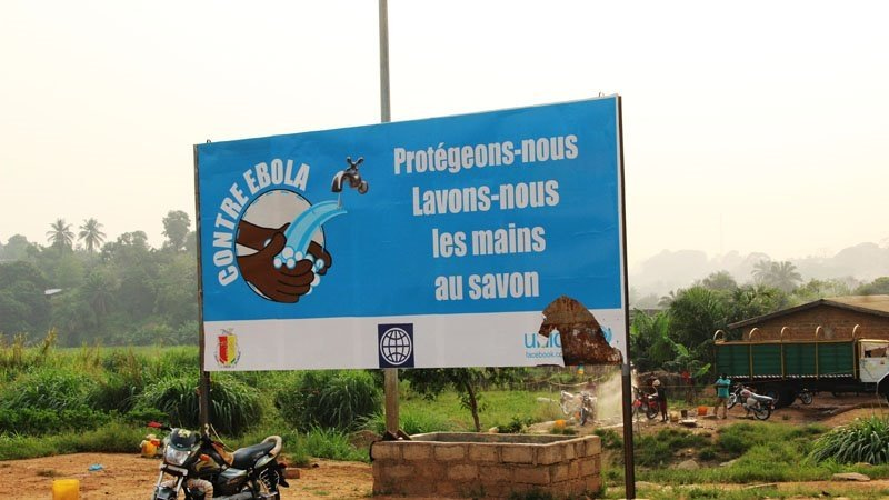 A billboard reading: Against Ebola - Let's protect ourselves. Hand-wash with soap