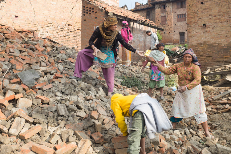 In Bhaktapur village, 12km from the capital Kathmandu, families dig through piles of rubble, trying to recover whatever they can from the ruins of their homes after a 7.8-magnitude earthquake hit Nepal on 25 April.