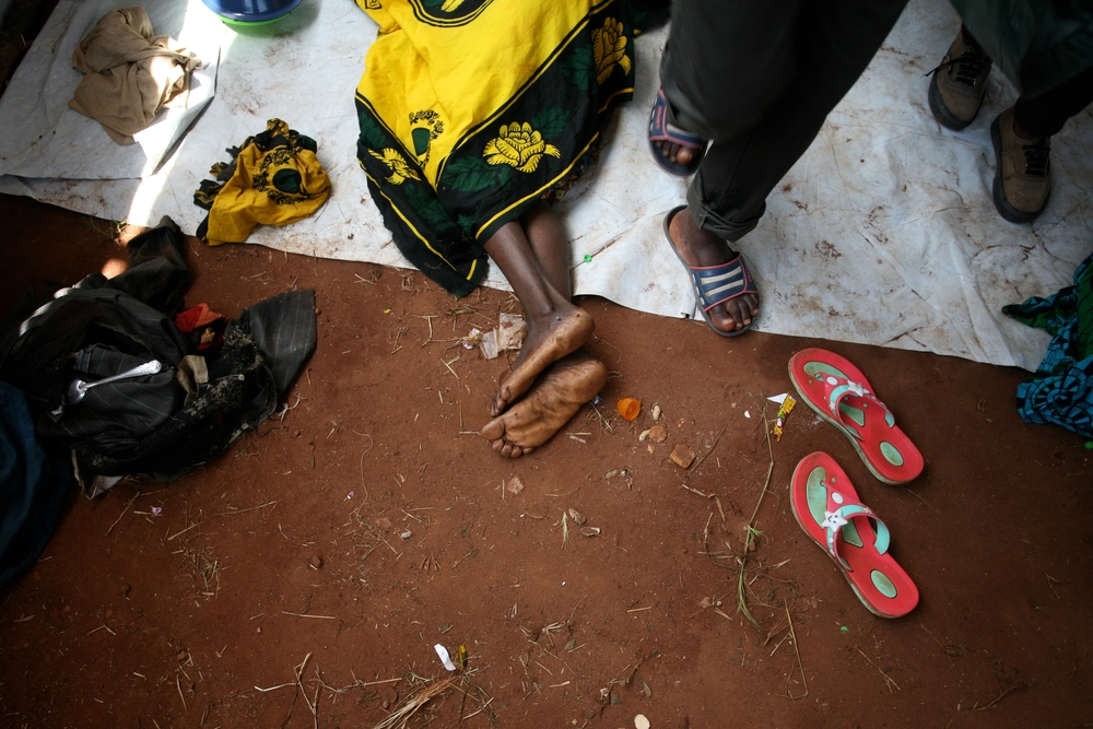 A Burundian woman suffering from suspected cholera lies in the health clinic at Lake Tanganyika Stadium in Kigoma, Tanzania, on 19th May 2015.