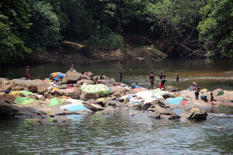 Many families in Guinea still rely on streams and lakes for their water needs.