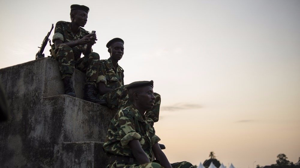 Soldiers from the Burundian armed forces sit next to a makeshift polling station in the Musaga neighbourhood of Bujumbura, Burundi, on June 28, 2015.Burundians are set to vote in legislative elections tomorrow, which opposition parties have called to boyc