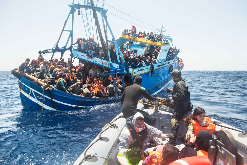 Refugees and migrants, packed aboard a fishing boat in the hope of reaching Europe. They were rescued by the Italian Navy as part of their Mare Nostrum operation in June 2014.