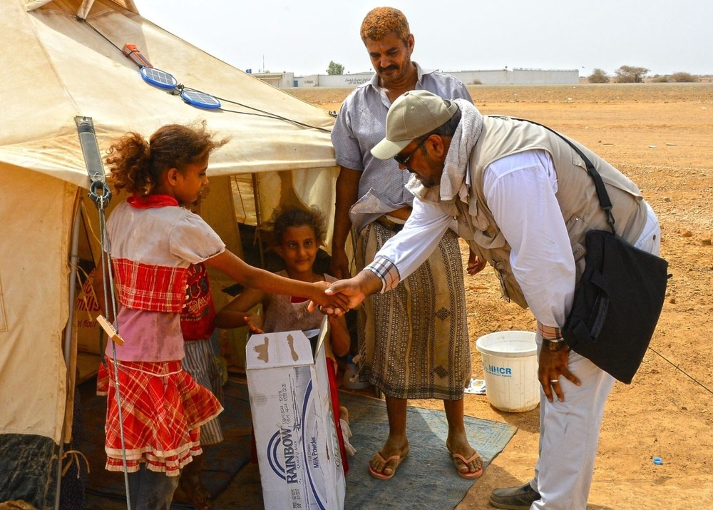A photo released by the King Salman Center for Humanitarian Relief showing aid workers with displaced Yemenis in Djibouti