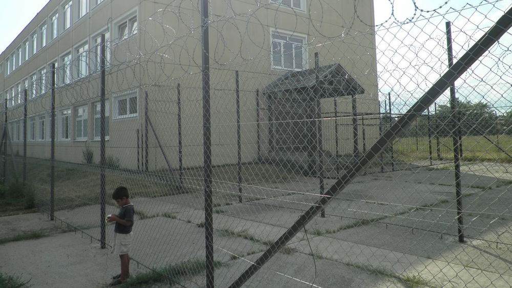 """Razor wire surrounds Debrecen centre for asylum seekers in eastern Hungary. Parts of the centre are """"open"""" but the facility also contains a unit for detaining asylum seekers considered at risk of absconding."""