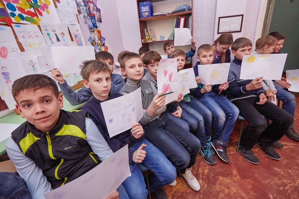 Children in Slovyansk school #9, Ukraine, telling their stories of war through drawings