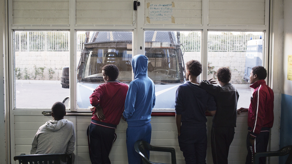 A group of young Eritreans at a migrant reception centre in Pozzallo, Italy
