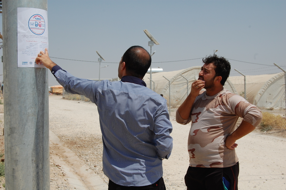 A WFP employee in Iraq explains a new phone center based in Kurdistan
