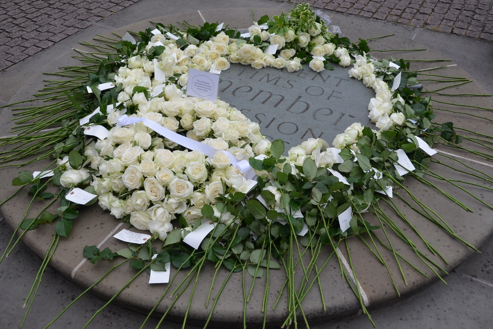 Flowers laid outside Westminister Abbey in London, United Kingdom during a memorial on 18 August 2015 for humanitarian aid workers killed in the course of their work. The commemoration, the second of its kind in the UK, fell the day before World Humanitar