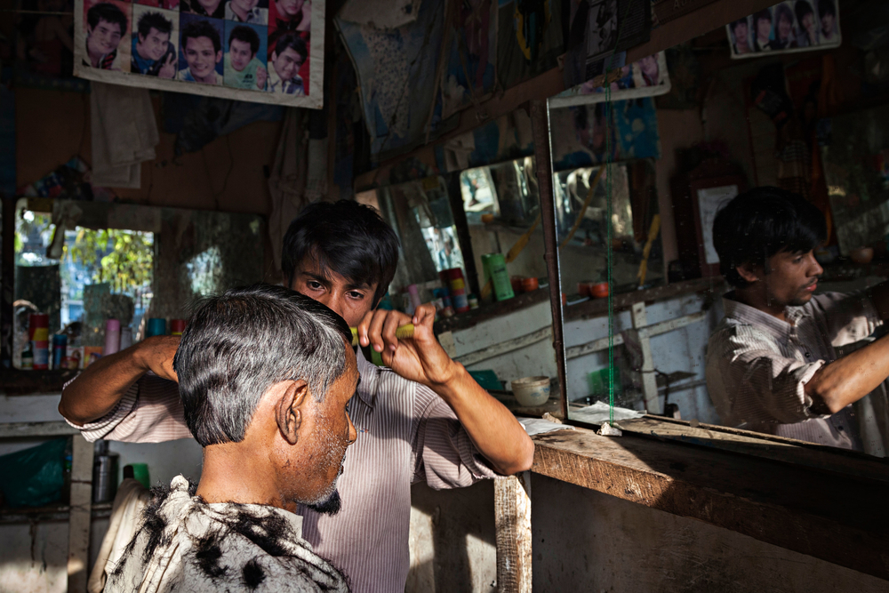 A Rohingya man gets his hair cut in the main market in Buthidaung, a township in Myanmar's western Rakhine State in early 2014.