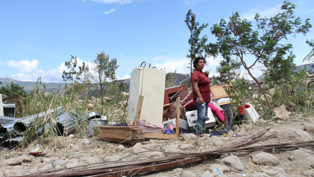 Blanca María Riobó crossed the Tachira River back into Colombia with her belongings, after authorities in Venezuela slated her home there for destruction.