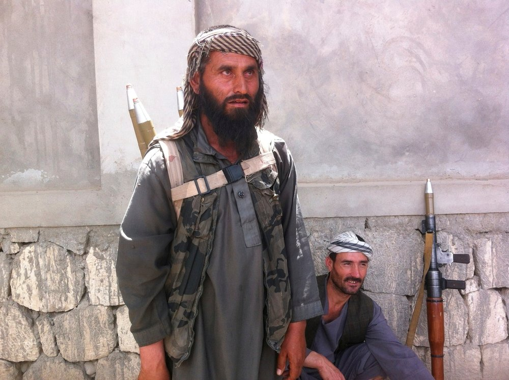 "A member of a militia led by Mohammad Omar (also known as ""Pakhsaparan"" or wall crusher) is pictured on April 2015 in Afghanistan's Kunduz city after being driven out of Khanabad district by the Taliban."