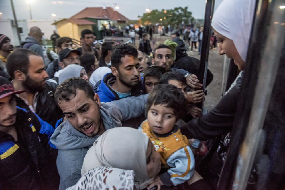 Migrants and refugees cram into a bus leaving an interim reception centre in Kanjiza, northern Serbia, for the Hungarian border. There was a rush to reach the border before Hungary closed it on 15 September, 2015.