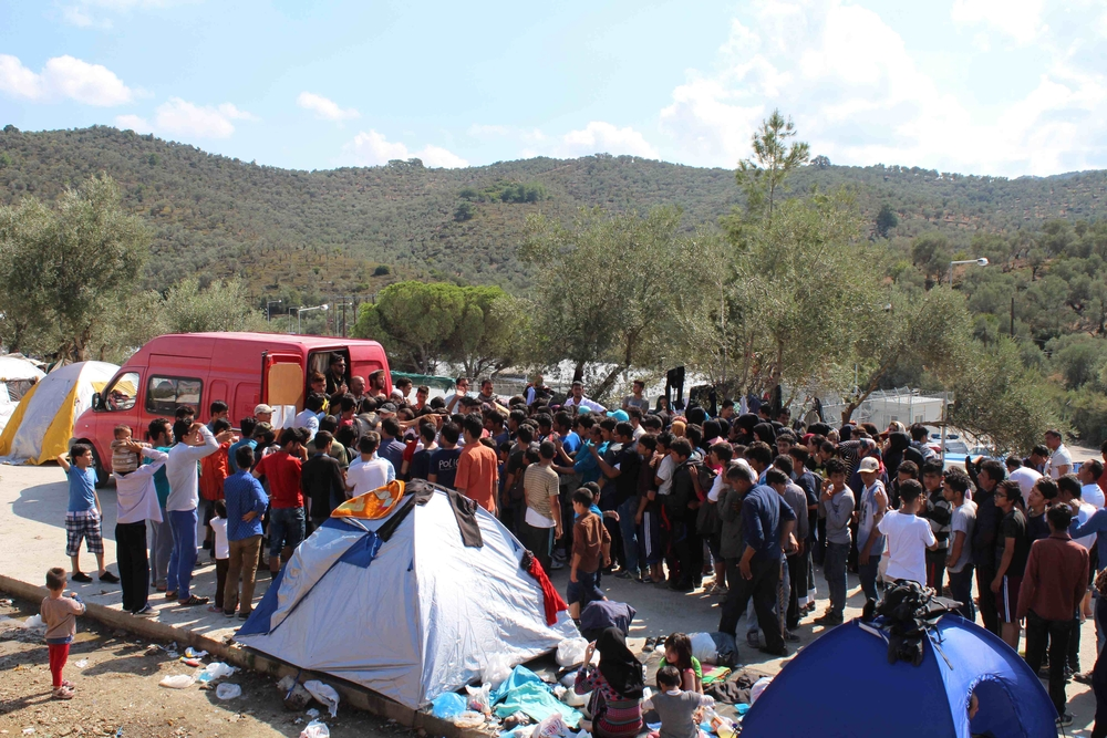 Non syrian refugees jostle for food at a volunteer distribution in Moria camp, Lesbos. Many have spent all their money getting to Greece and have no cash even for basics such as food.