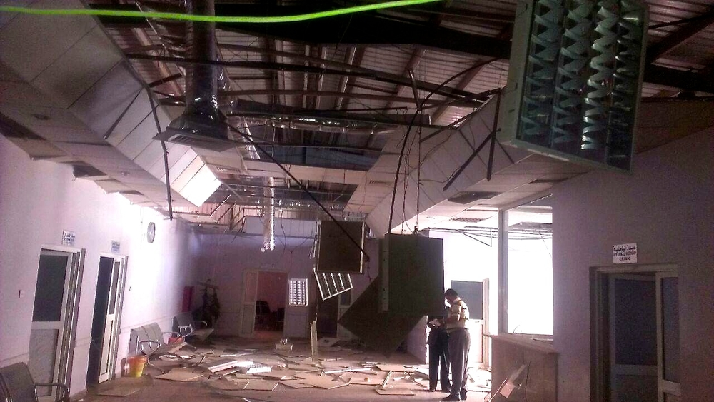Staff inspect the Military Hospital in Sana'a after it was hit by an airstrike by the Saudi Arabia-led coalition.