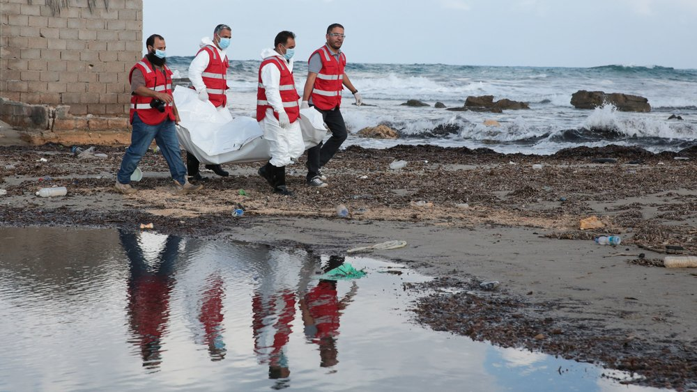 Tripoli Red Crescent teams salvage another body, distorted and bloated by days floating in the sea water