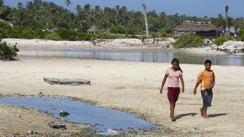Locals in Tebikenikora, a village in the Pacific island nation of Kiribati that is on the frontline of climate change