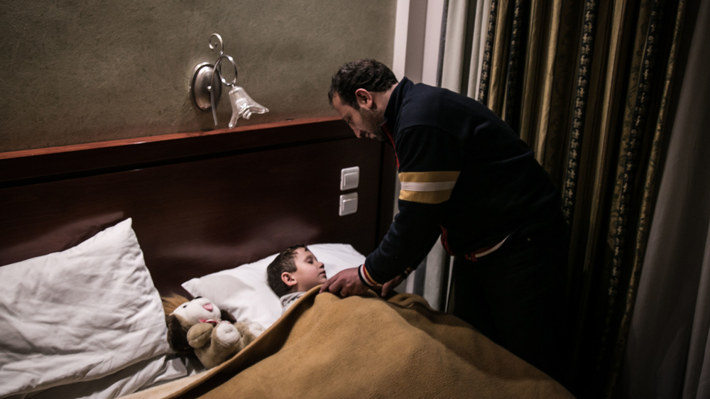 Maher Dahood, who lost his wife and two daughters on the boat trip to Greece, is now the sole carer of his three-year-old son. They are waiting to be relocated from Greece in an Athens hotel.