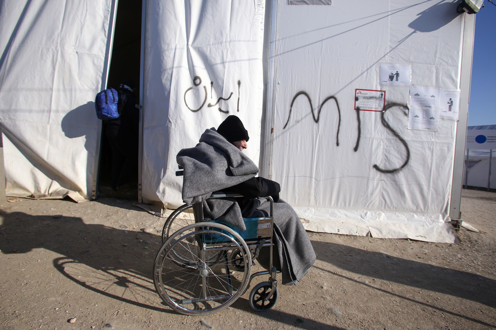 A disabled refugee at the transit camp in Idomeni near Greece's border with Macedonia. Many refugees and migrants making the journey through Europe are elderly or disabled. NGOs provide them with wheelchairs and medical assistance.