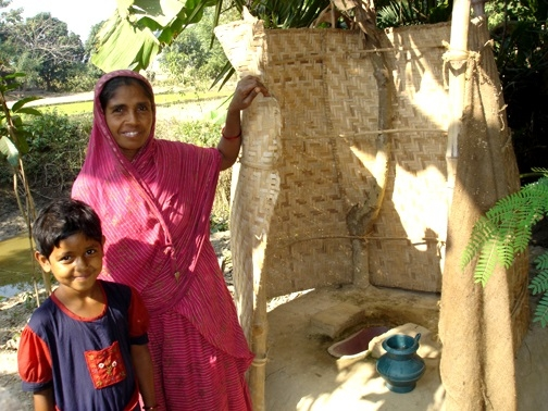 Woman and her new latrine.