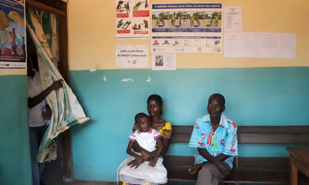 Patients sit at a health centre in Wangata in 2018