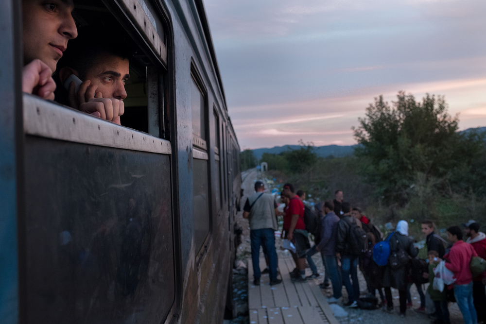 Asylum seekers prepared to board a train in Macedonia