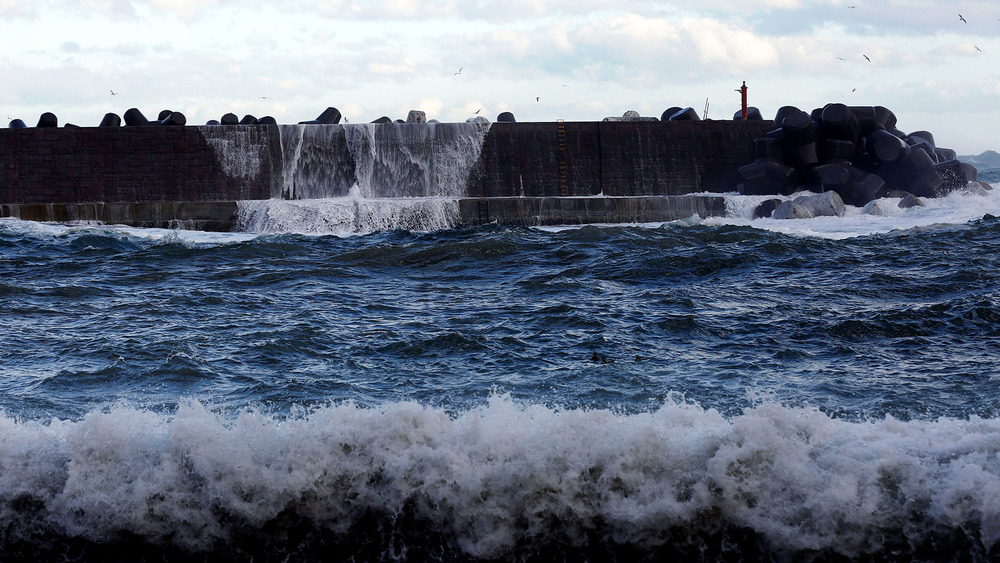 A high wave hits a seawall in Tanohata village, Iwate Prefecture, Japan one of the areas hit hardest by the 2011 earthquake and tsunami.