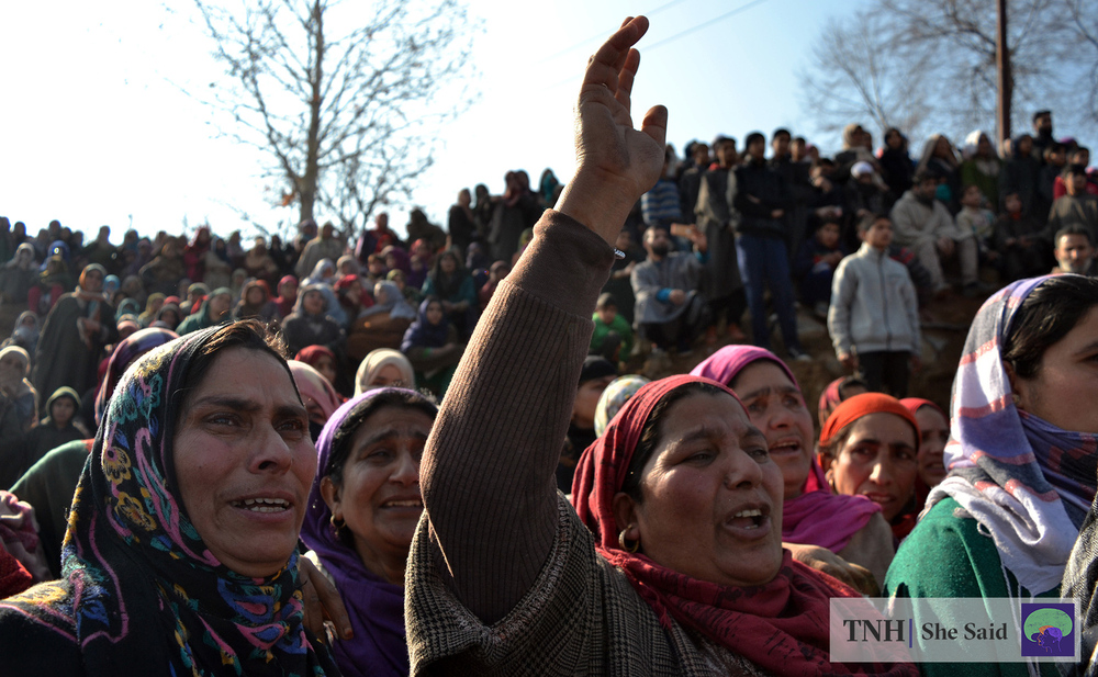 Women shout slogans during a funeral