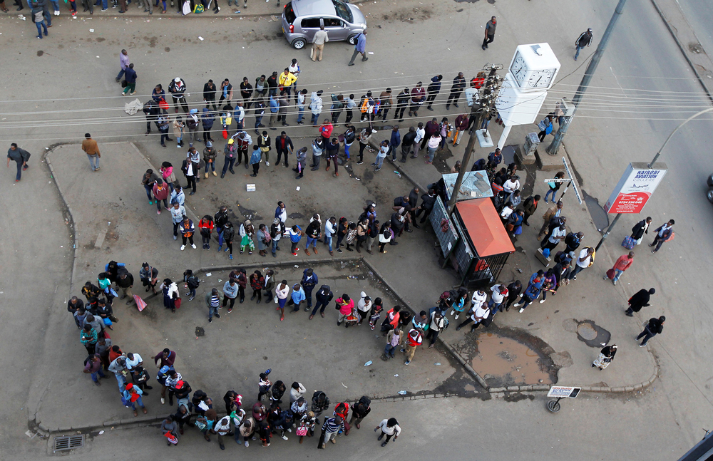 People queuing for public transport in downtown Nairobi