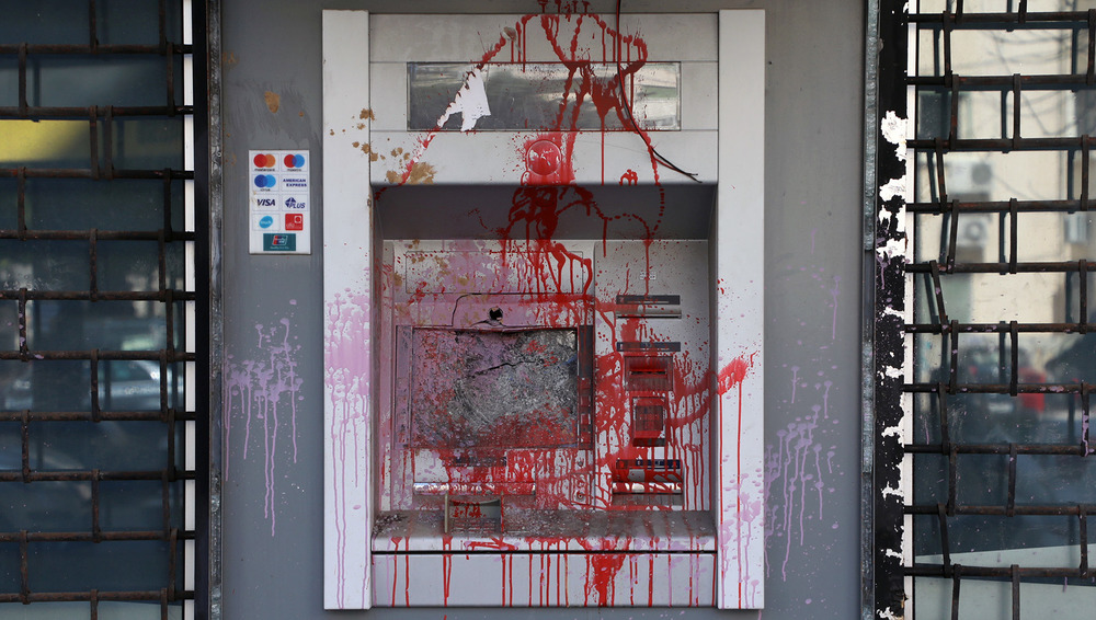 A damaged ATM cash machine is pictured in Beirut, Lebanon 17 March, 2021.
