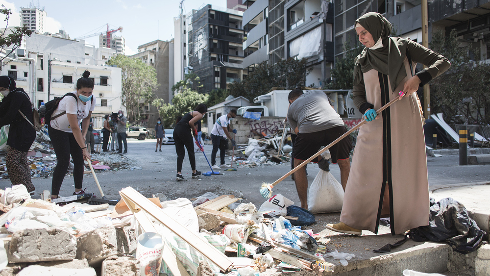 Volunteers clean up the damage in Beirut