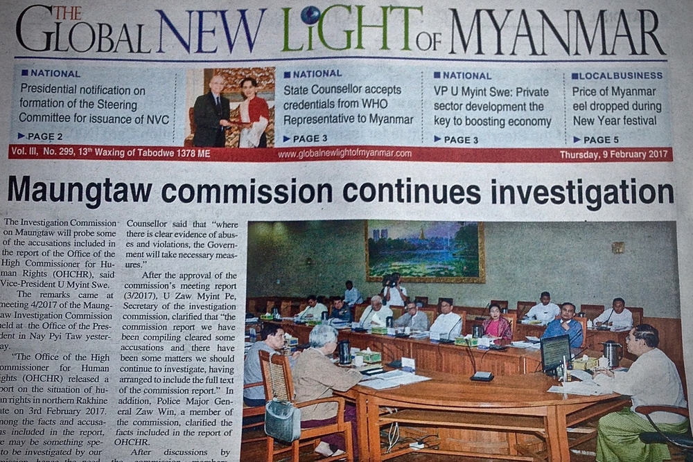 The front page of Myanmar's state-run newspaper on 9 February 2017 carried two articles about government attempts to investigate alleged military abuses of Rohingya