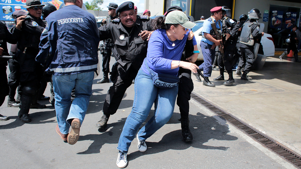 Riot police dislodge a demonstrator during a protest in Managua