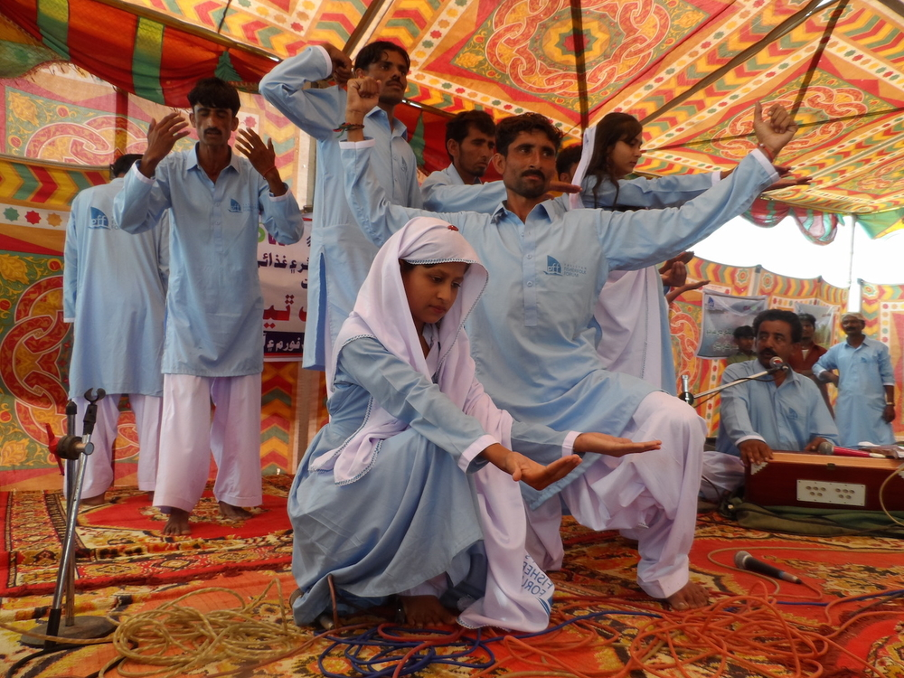 Actors perform a skit to raise awareness of the impact of climate change in Badin District, in Pakistan's Sindh Province, in October 2016