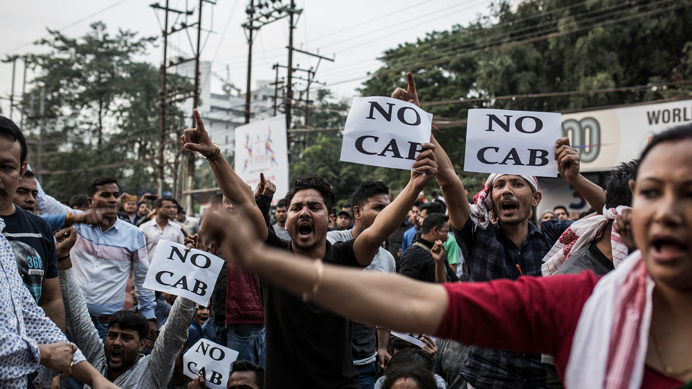 Protesters hold signs denouncing changes to India's citizenship laws during a demonstration in Guwahati.