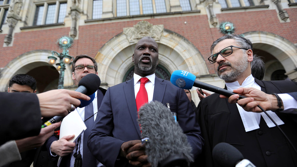 The Gambia's justice minister, Abubacarr Tambadou, talks to the media outside the International Court of Justice.