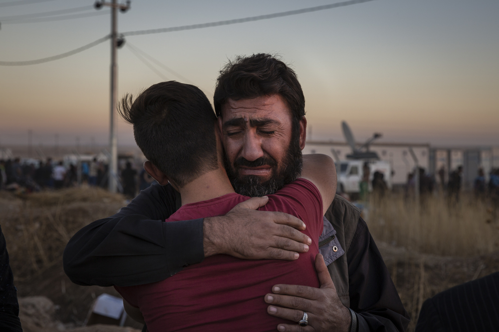 Iraqi men hugging