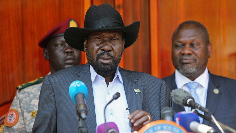South Sudan's President Salva Kiir Mayardit speaks into a microphone behind a podium.