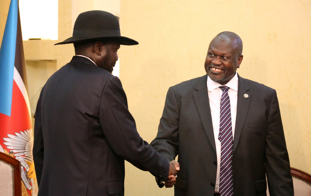 South Sudan's President Salva Kiir shakes hands with Riek Machar, ex-vice president and former rebel leader, during their meeting at the State House in Juba.