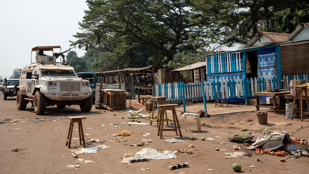 A peacekeeper truck stationed on the outskirts of the capital city of Bangui next to a closed up fruit stand.