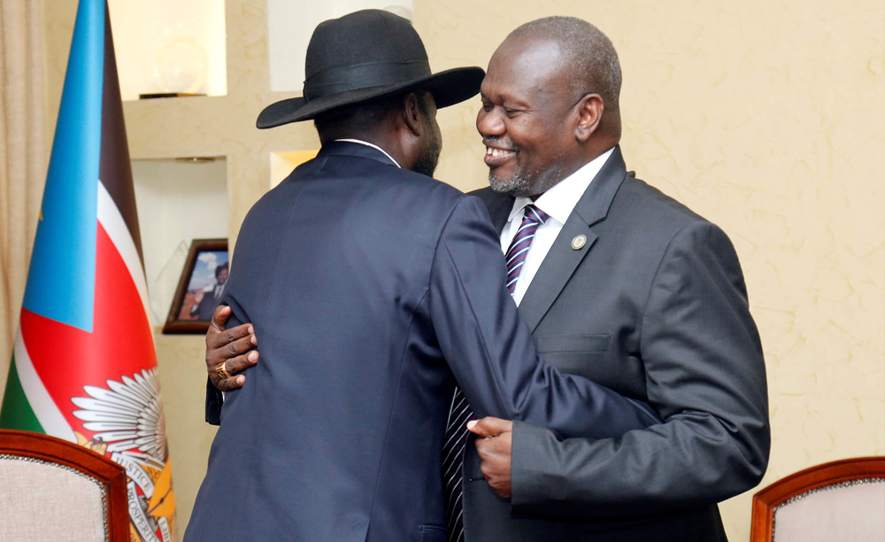 South Sudan's President Salva Kiir embraces Riek Machar, now vice president again, during a meeting at the State House in Juba on 15 January 2020.