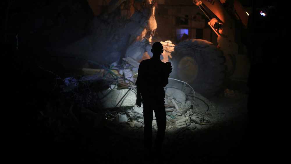 A resident inspects damage in Douma