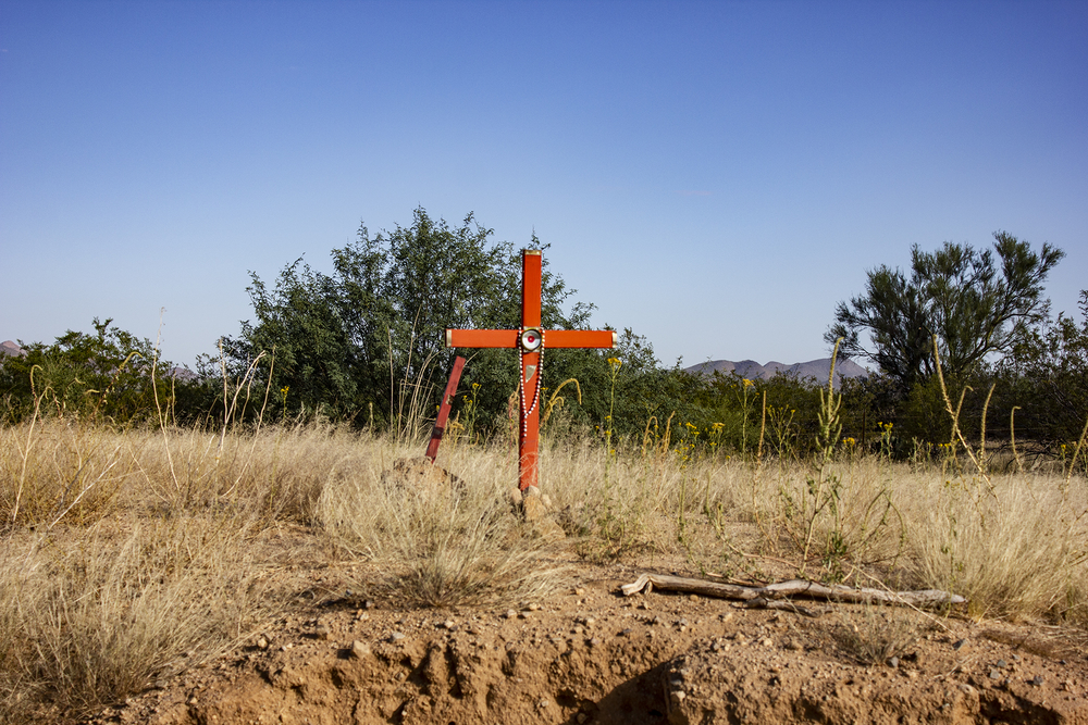 A cross on a small hill