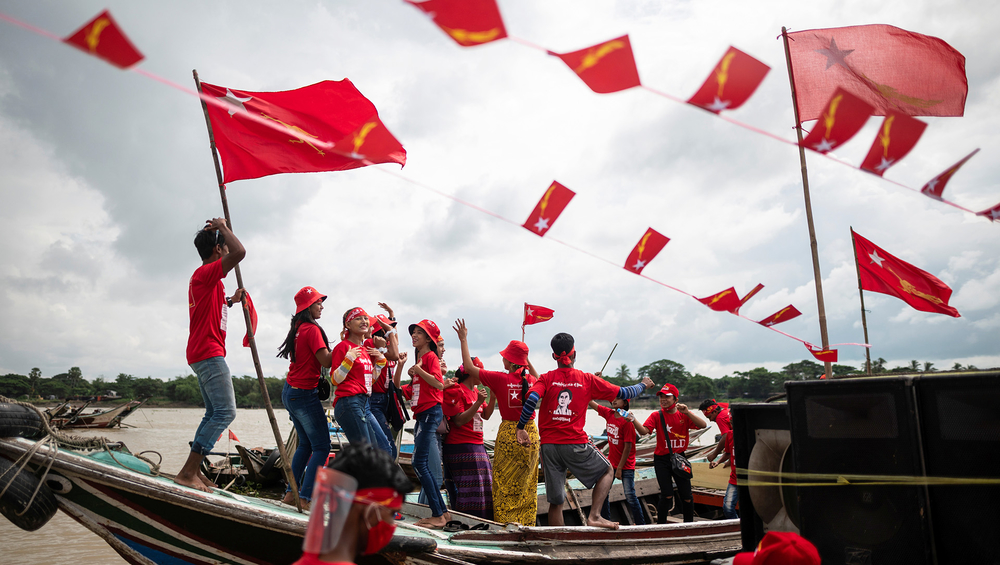 People stand on a boat in a rally in the run-up to elections in Myanmar.