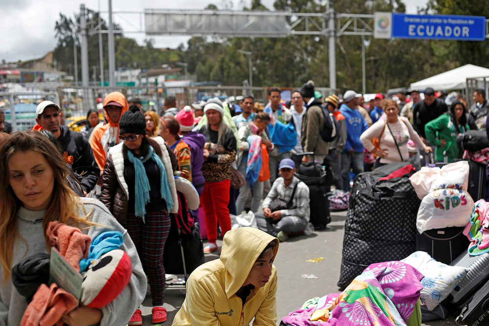 Venezuelan citizens and other migrants wait at the border with Colombia.